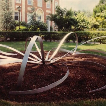 sculpture by kim, circular, large and silver